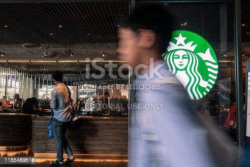 Bangkok, Thailand - April 20, 2018 : Starbucks coffee logo in front of the shop in Bangkok.