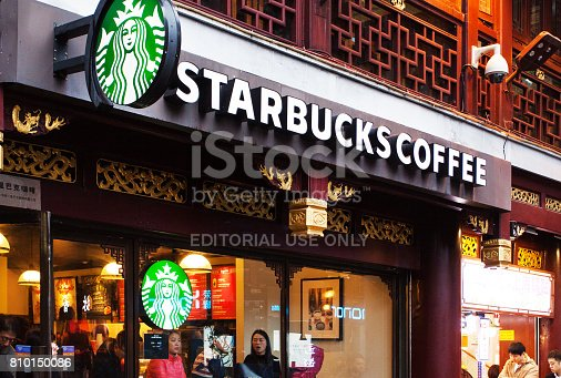 People having a break outside and inside the Starbucks Coffee located in Shanghai Yuyuan Old Street. Starbucks Corporation is the world's largest coffee house chain. It is head-quartered in Seattle, Washington, USA, where the first store opened in 1971.