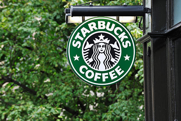 Starbucks coffee sign hanging outside a shop stock photo