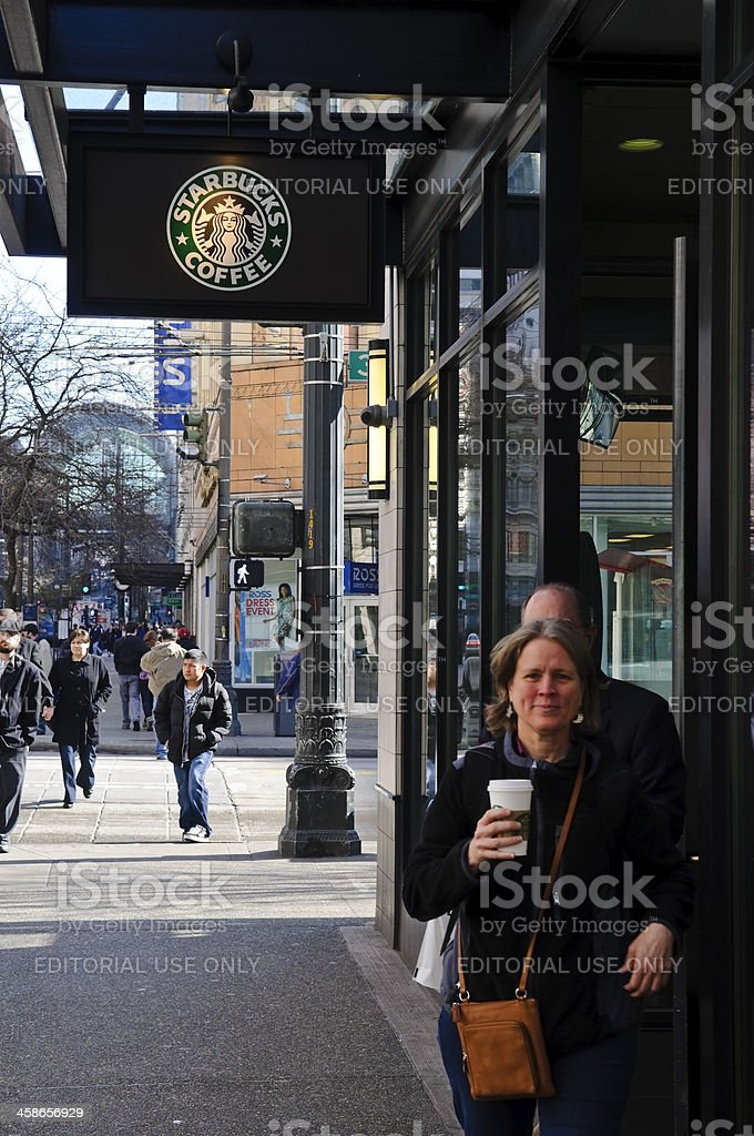 Starbucks customers exiting store in Seattle, Washington royalty-free stock photo