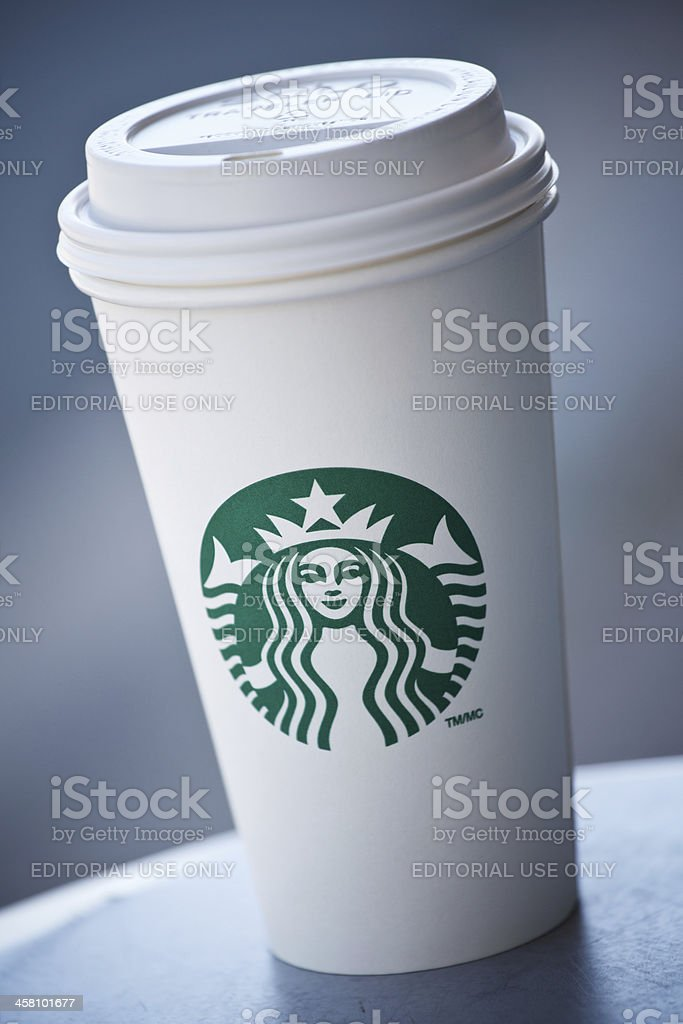 Starbucks grande sized to go cup sitting on a table royalty-free stock photo