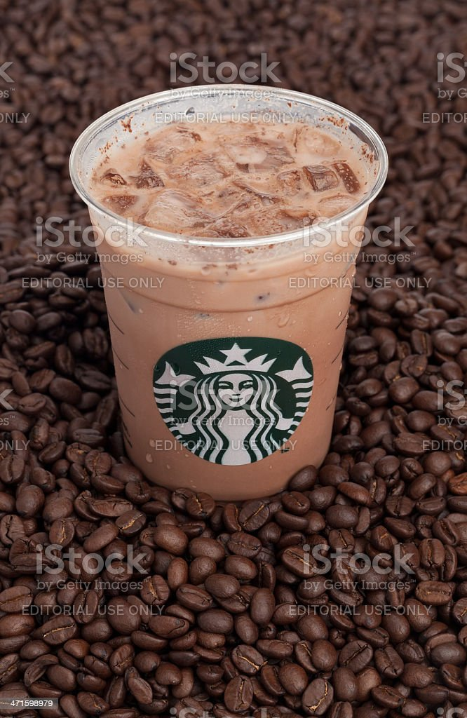 Starbucks Iced Coffee on a Heap of Beans stock photo