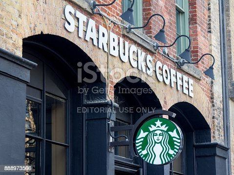 Picture of a Starbucks cafe in downtown Toronto, Ontario, Canada. Starbucks Corporation is an American coffee company and coffeehouse chain operating worldwide