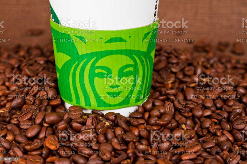 Starbucks Take-Out Coffee Cup with Beans royalty-free stock photo