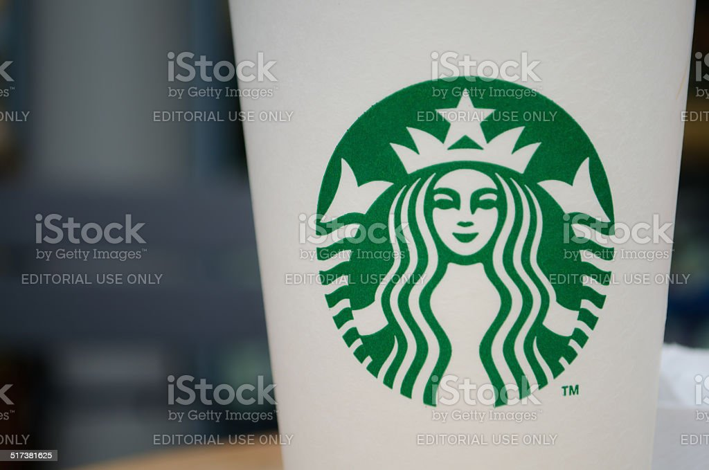 Starbucks to go cup on table stock photo