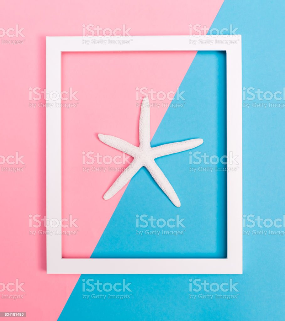 Starfish and frame on a bright background stock photo