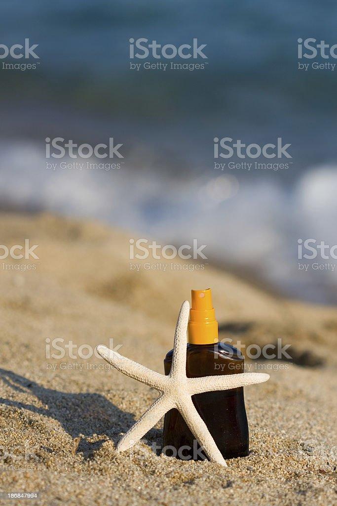 Starfish and lotion royalty-free stock photo