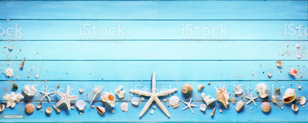 Starfish And Seashell On Blue Plank stock photo