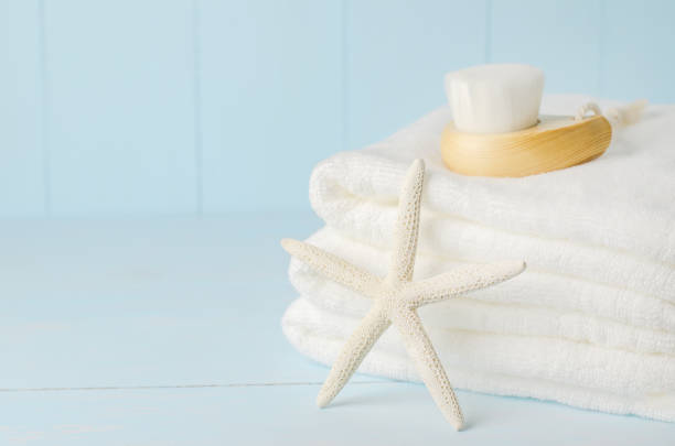Starfish and white towels with Facial cleansing brush stock photo
