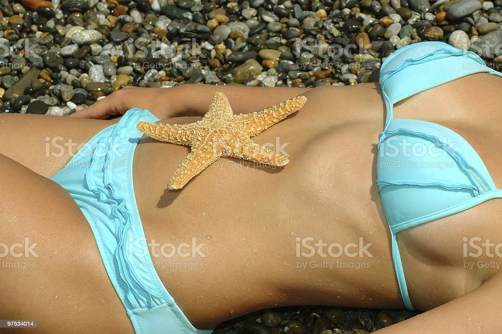 Starfish on a stomach royalty-free stock photo