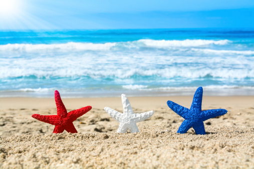 Starfish On Beach During July Fourth Stock Photo - Download Image Now