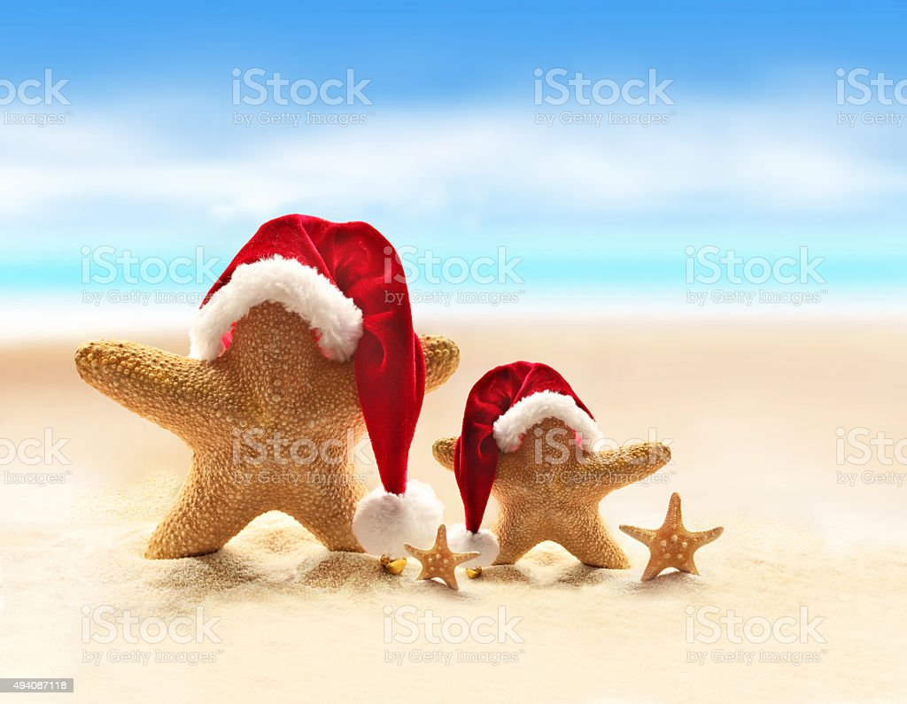 Starfish on summer beach and Santa hat stock photo
