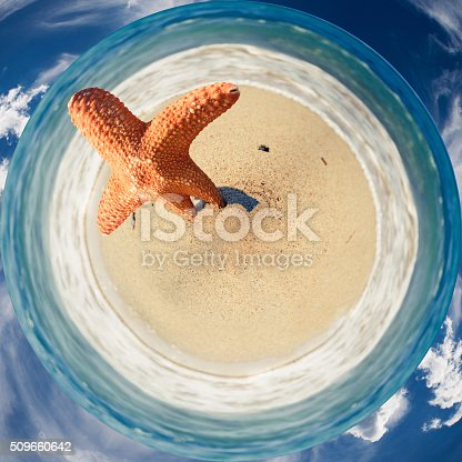 360 degree panorama of a starfish on the beach, waves, sea and cloud around