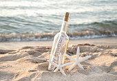 starfish with anniversary message in bottle