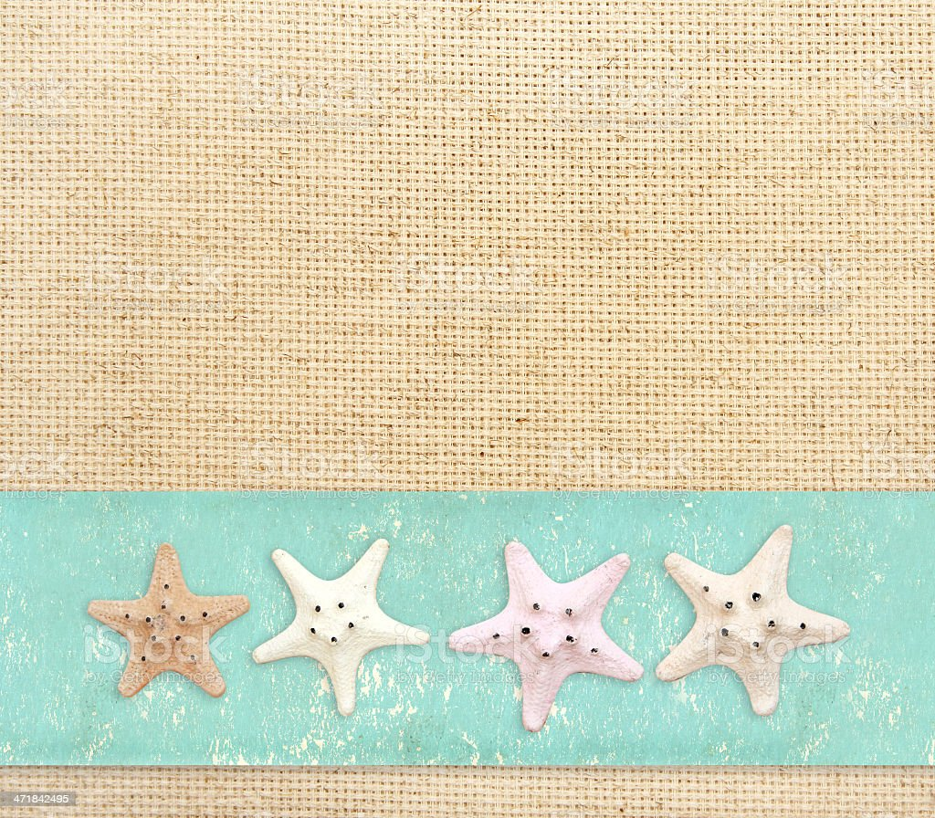 Starfishes on canvas texture royalty-free stock photo