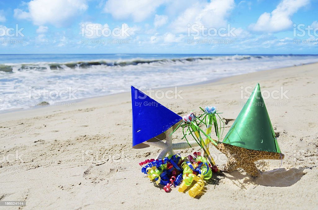 Starfishes with Birthday decorations on the beach royalty-free stock photo