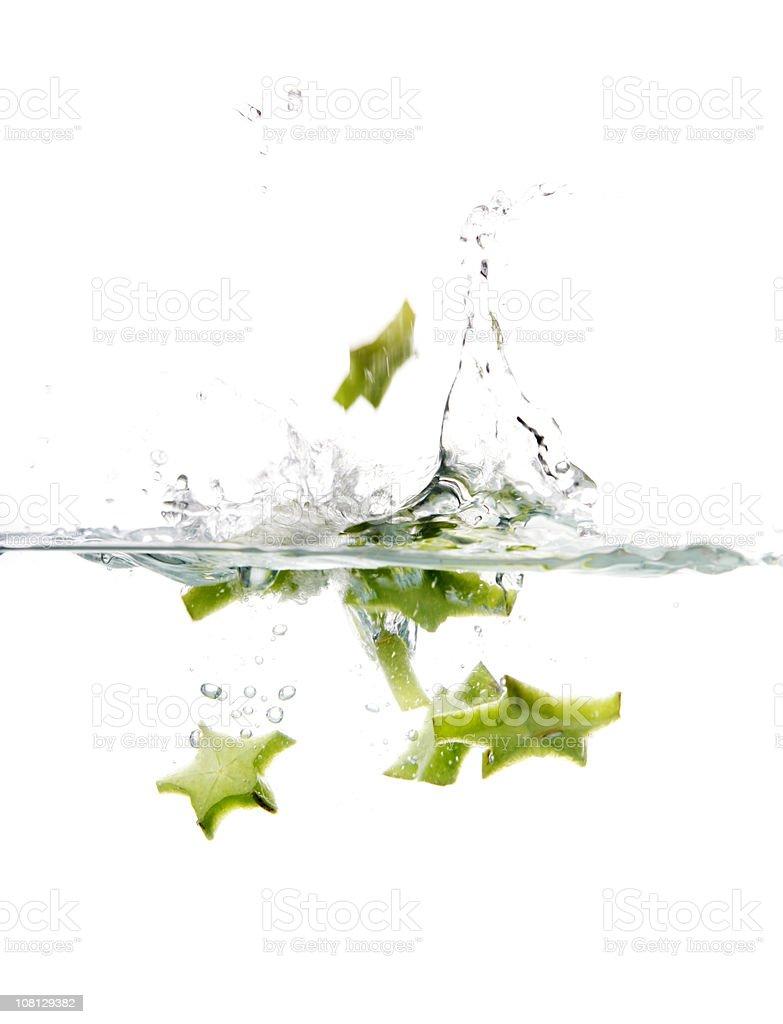 Starfruit Splashing in Water stock photo