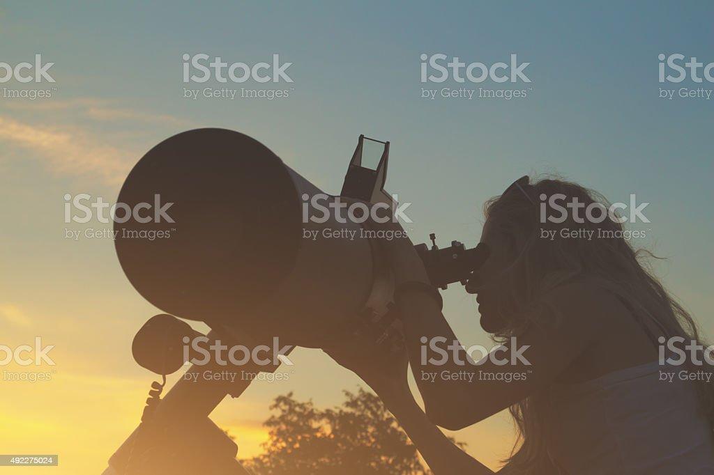 Stargazing through a telescope at dawn/dusk stock photo