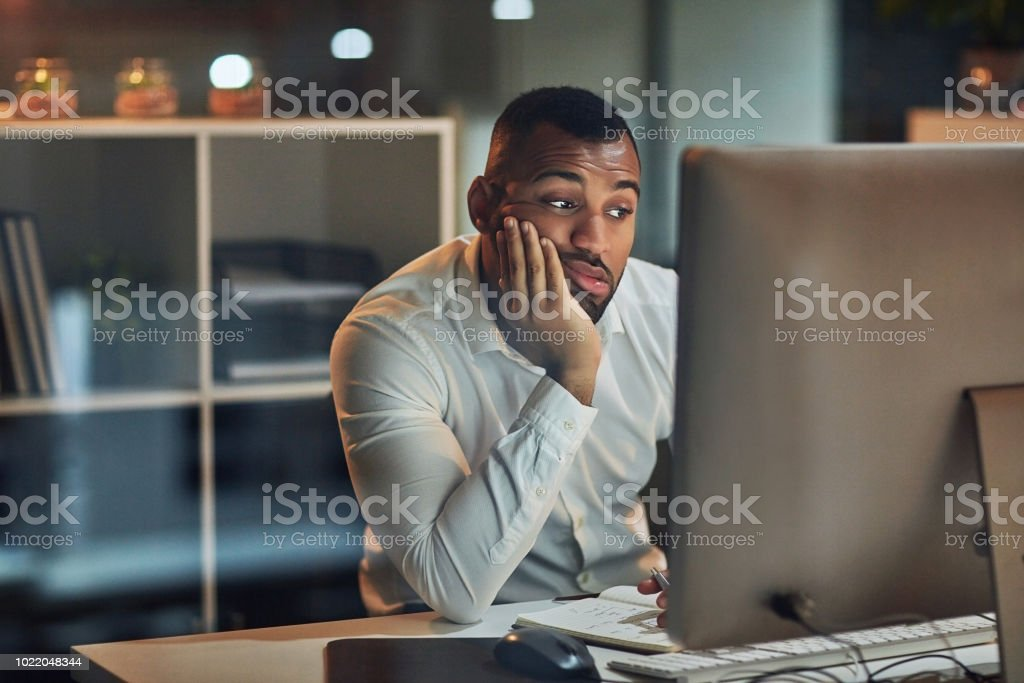 Staring at the screen but nothing's going in stock photo
