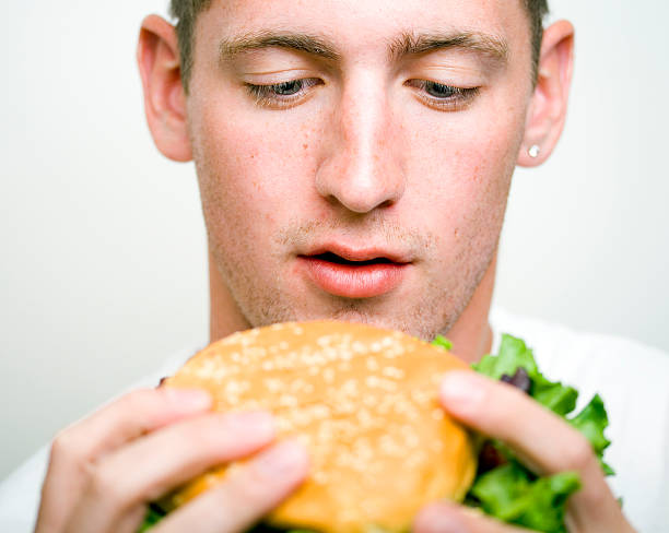 Staring down the burger stock photo
