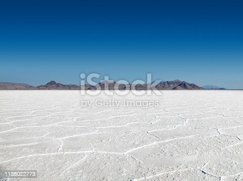 Panoramic view of the stark white Bonneville Salt Flats with mountains in the distance