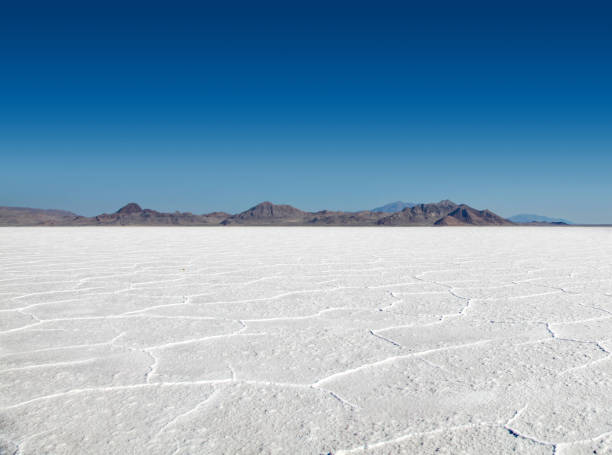 Stark Beauty of the Bonneville Salt Flats Panoramic view of the stark white Bonneville Salt Flats with mountains in the distance bonneville salt flats stock pictures, royalty-free photos & images