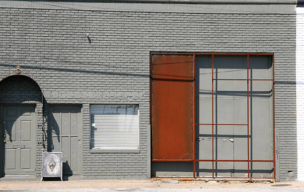 Stark, grey wall with Mondrian-like rusty iron works
