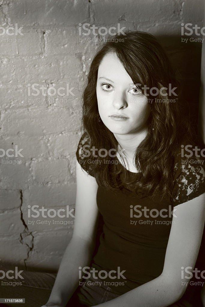 stark portrait of waif teenager in corner royalty-free stock photo