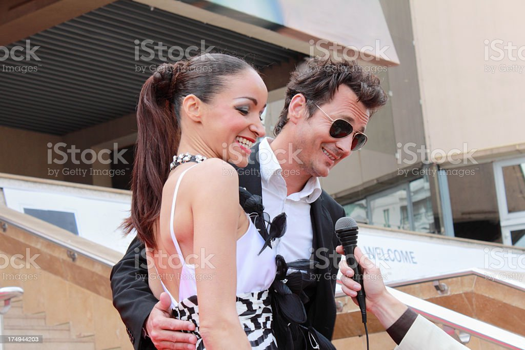 starlet celebrity and actor interviewed on stairway royalty-free stock photo