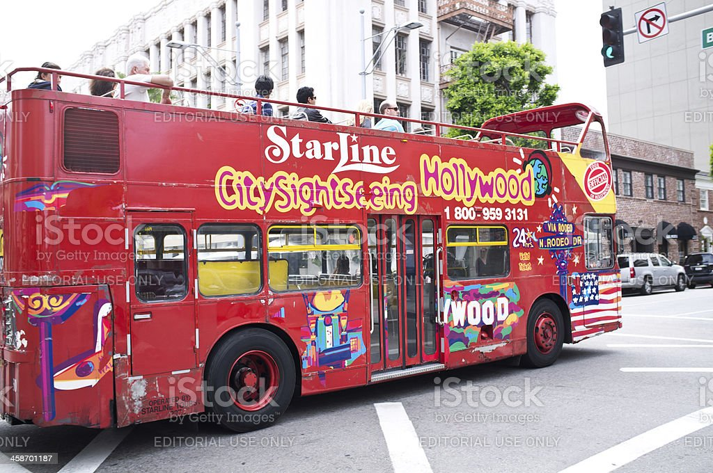 Starline tour bus driving tourist through Beverly Hills royalty-free stock photo