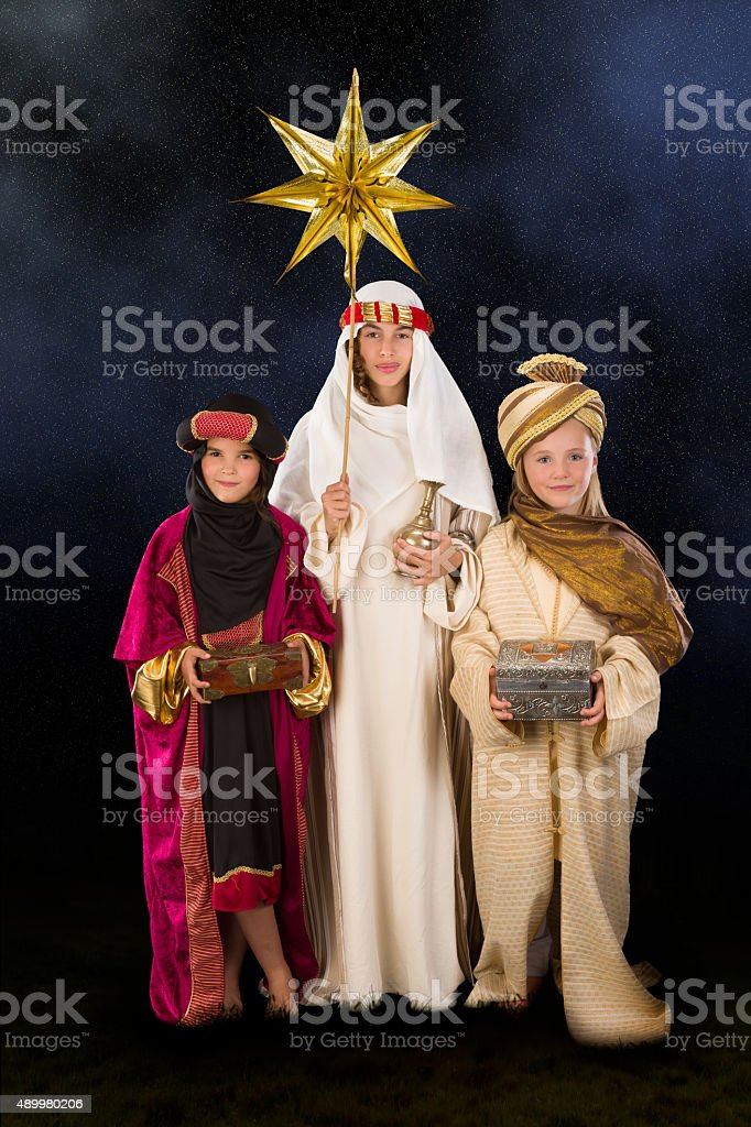 Starry christmas night with wisemen stock photo
