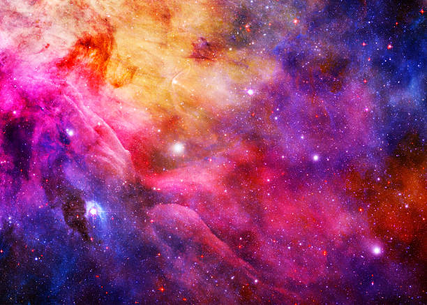 Starry Galaxy - Elements of this Image Furnished by NASA A galaxy thrums and churns, glowing brilliantly from the darkness of space. nebula stock pictures, royalty-free photos & images