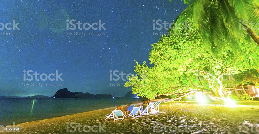 Starry night above beautiful tropical beach royalty-free stock photo