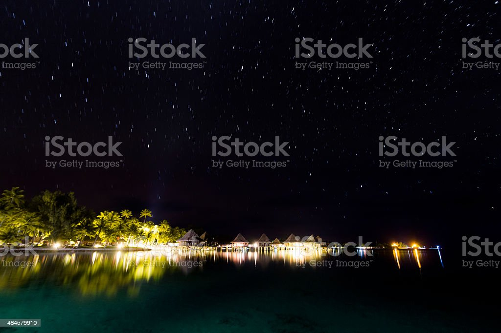 Starry Night Over a Beach in Rangiroa, French Polynesia stock photo
