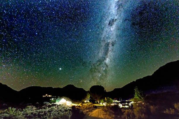 Starry night over campsite stock photo