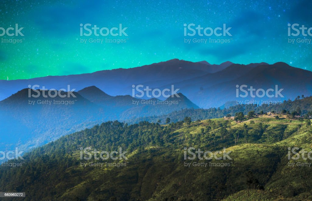 Starry night over the mountain with milky way sky at Thailand stock photo