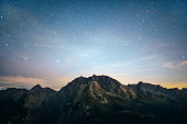 Starry sky under the mountains
