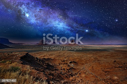 istock starry night sky in monument valley 537621432