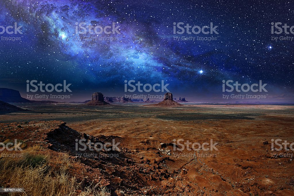 starry night sky in monument valley stock photo