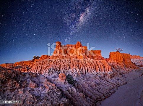 Starry skies over desert landscape in remote outback Australia