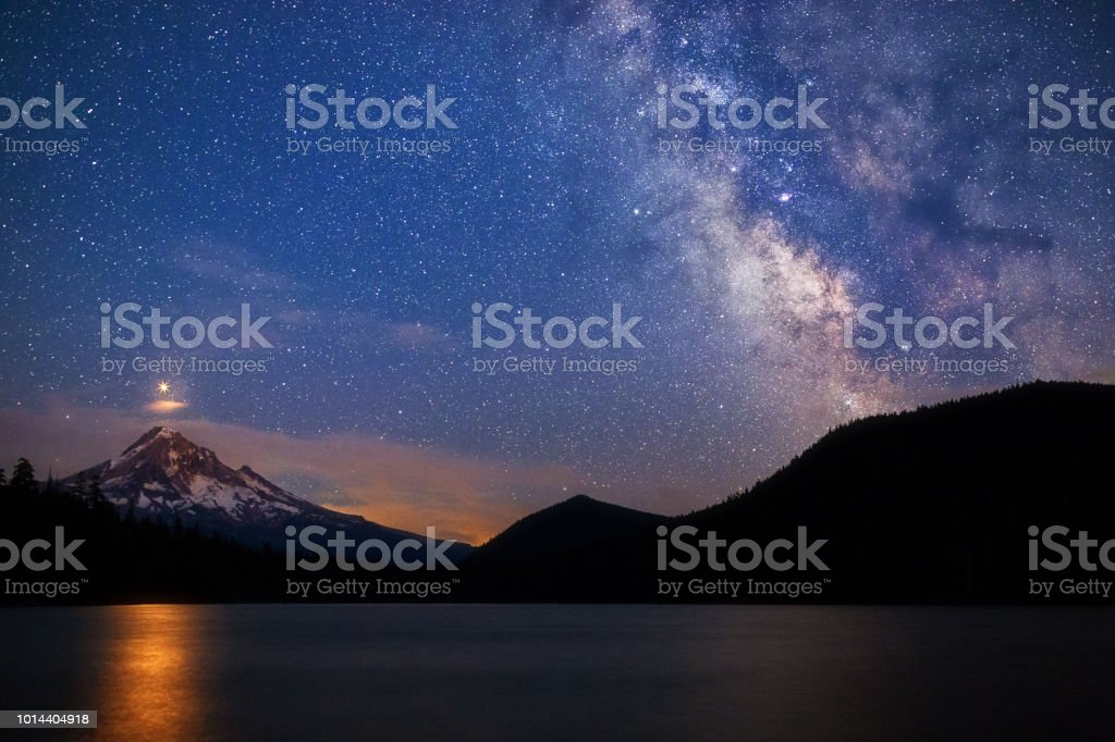 Starry night sky with Mars rising over Mt. Hood from Lost Lake, Oregon, USA. royalty-free stock photo