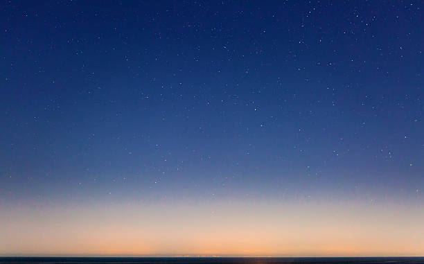 Starry Sky and the Sicily Coastline Sicily as seen on the horizon from Malta, on a clear and starry night. twilight stock pictures, royalty-free photos & images