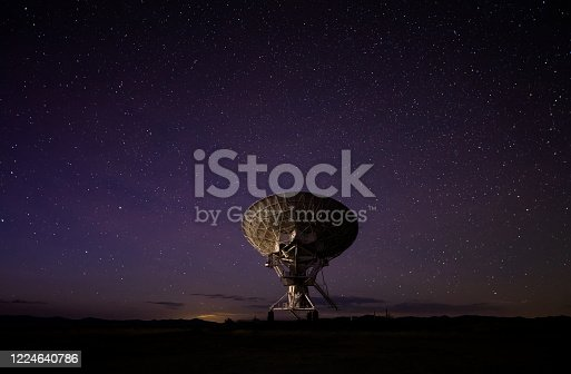 A massive radio telescope at the Very Large Array at Socorro, New Mexico. The array is a facility of the National Radio Astronomy Observatory