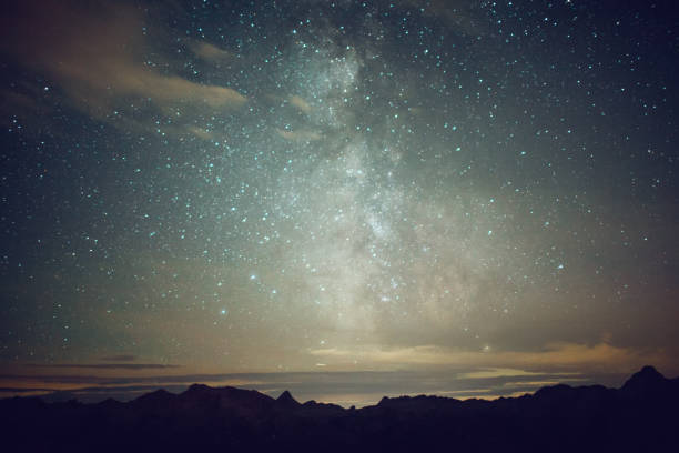 Starry sky over the mountains at night stock photo