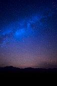 Stars in the dark deep blue starry sky over the Nevada's desert