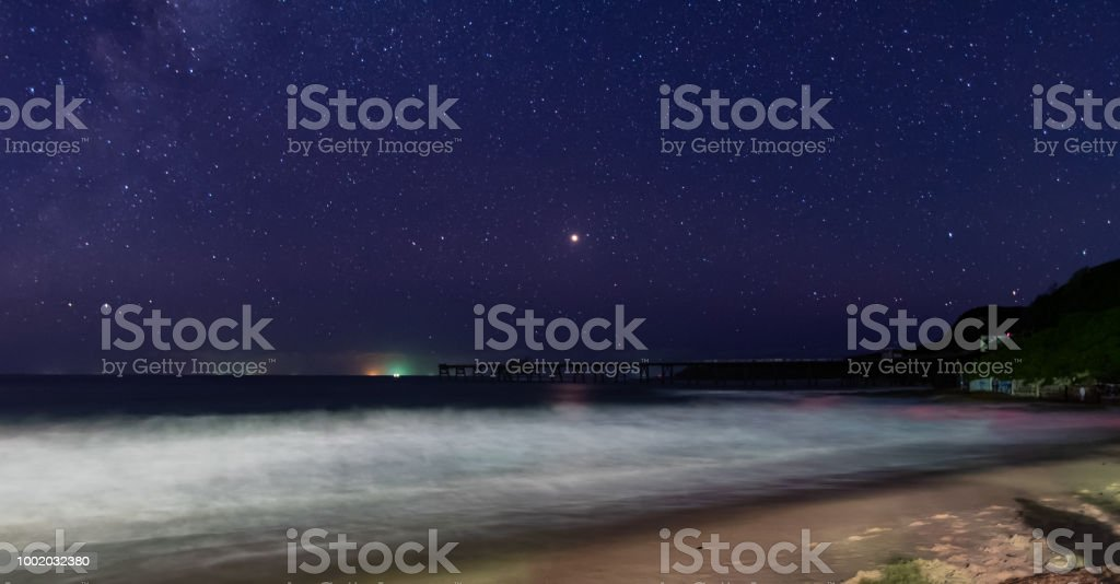 Starry, starry sky and seascape stock photo