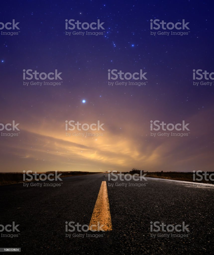 Stars Above Open Lone Road During Sunset royalty-free stock photo