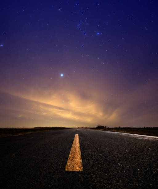 Stars Above Open Lone Road During Sunset stock photo