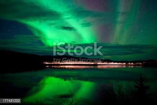 istock Stars and Northern Lights over dark Road at Lake 177431222