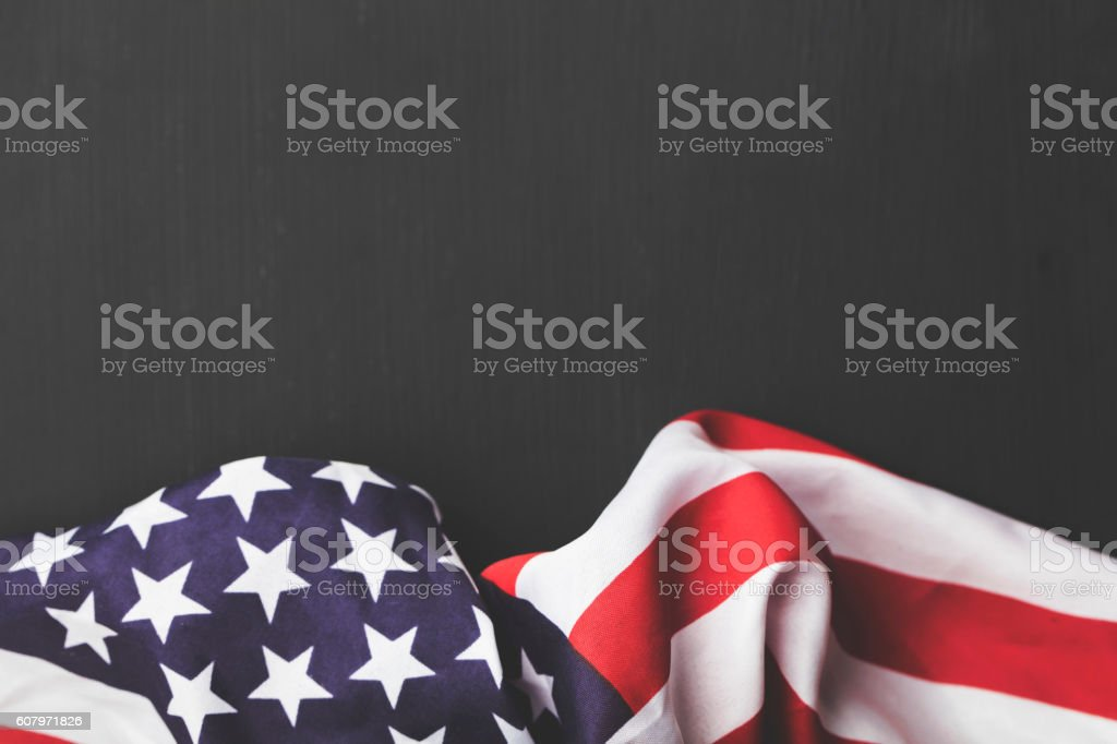 USA stars and stripes flag on a dark chalkboard background stock photo